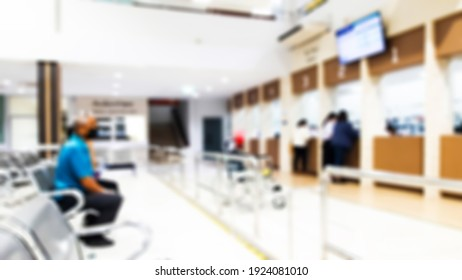 Blur image of people coming to the checkout counter at the hospital.