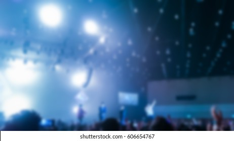 blur image of people in concert hall with live band.