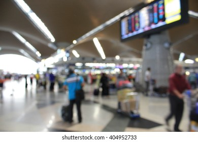 BLUR IMAGE OF PEOPLE AT KUALA LUMPUR INTERNATIONAL AIRPORT FOR BACK GROUND USES