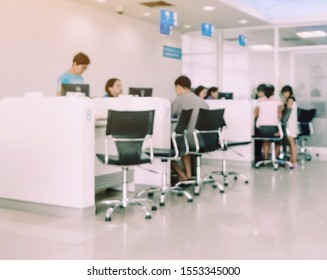 Blur image of people sit and waiting in financial transactions in the bank.