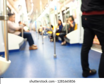 Blur image of people in skytrain, Blurred image of people sitting on the skytrain of the public transport.