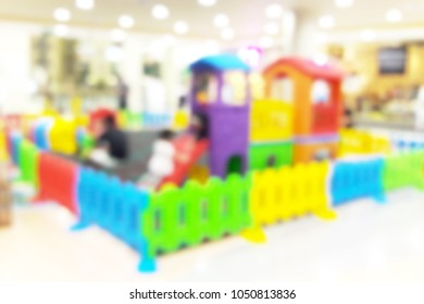 Blur image of playground in the mall, use for background.