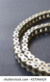 Blur image of Roller chains for motorcycles, for background usage.