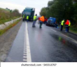 Blur image with scene of an accident between a truck and a car