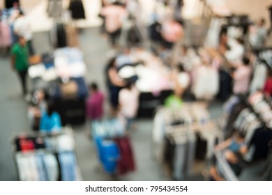 Blur image of Shopping mall or exhibition hall and people for background usage