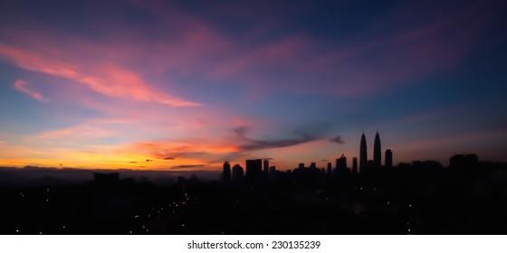 Blur image silhouette of Kuala Lumpur city panorama during sunrise
