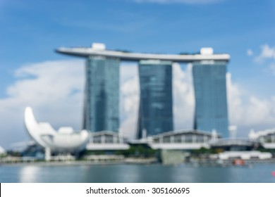Blur image of singapore marina bay view with blue sky background