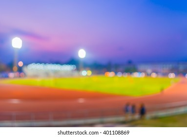 blur image of soccer stadium in twilight time for abstract background usage.