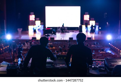 Blur image of sound engineer backstage crew team working to setting and preparing production for show events or music concert stage with blurry white screen in background. - Shutterstock ID 1447287752