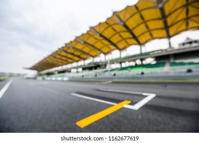 Blur image of starting grid race track. Motorsports racing circuit.