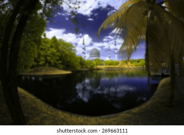 Blur Image Of Sultan Salahuddin Abdul Aziz Shah Mosque (also known as the Blue Mosque) by the lakeside viewed in infrared