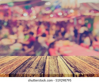 blur image of Tables and decoration prepared for birhtday party for background usage. (vintage tone).