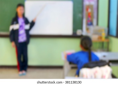 blur image of teacher in classroom