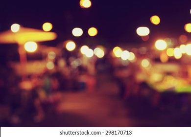 Blur image of tourists walk in night market