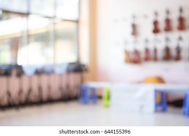 Blur image of violin classroom.