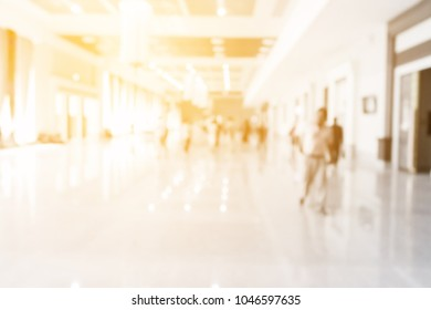 Blur image of walkway in a large building.