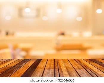 blur image of wood table and Abstract blurry sushi counter in vintage style decoration restaurant.