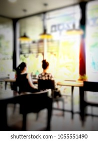 Blur interior restaurant coffee shop cafeteria warm light with customers
