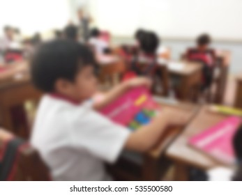 blur kids and teacher in the classroom for background usage.