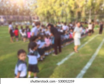 blur kids and teacher in the playground for background usage.