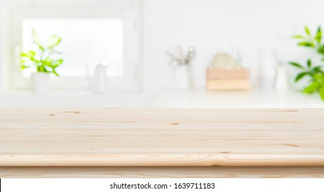 Blur kitchen interior background with table top for product display