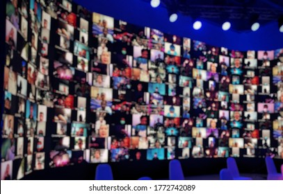 Blur large LED screen show many people's faces join big online event or virtual reality live conference. Big video call seminar, Work from home, Social distancing, New normal event production.