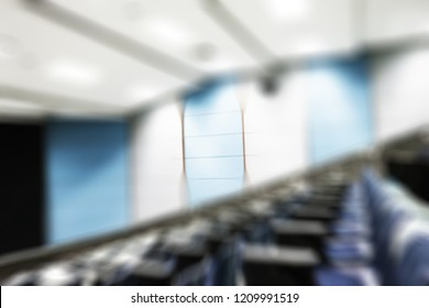 Blur lecture room or School empty classroom with desks and chair iron wood for studying lessons in high school thailand, interior of secondary education.