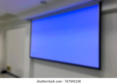 Blur light blue on screen in the meeting room.