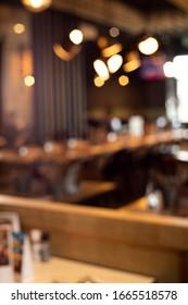 Blur light gold bokeh of cafe restaurant in dark background