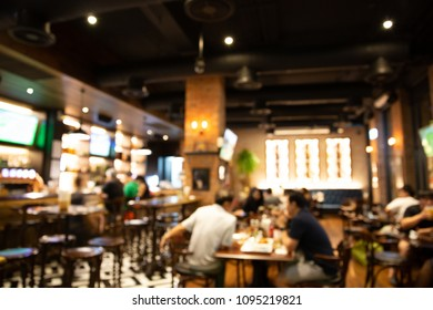 blur light in pub or bar and restaurant at night party background. Blurred background of restaurant with abstract bokeh light.