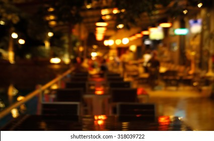 blur light in pub or bar and restaurant at night party background