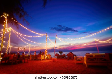 Blur the lights on the beach restaurant in Pattaya, Thailand.
