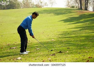Blur of man playing golf.