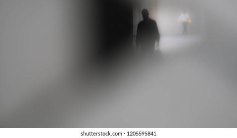 Blur man silhouette at a dark alley in Tokyo back street.