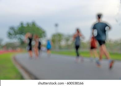Blur man with woman  running in park,thailand