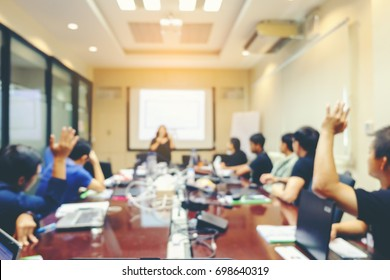 Blur Meeting room ready for a businessmen, work places, Glasses of water and notebooks on the table, conclude or accept