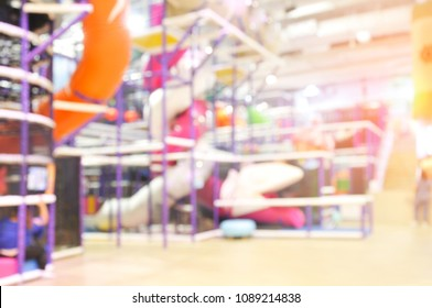 Blur a modern children playground indoor. A modern children playground indoor with long slide blur background