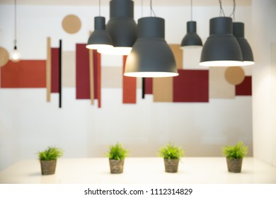 Blur of Modern and industrial style lamps decorated in a modern style. Modern interior design.
