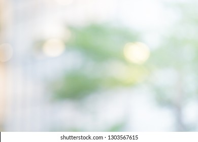 BLUR OF MODERN OFFICE INTERIOR WITH LIGHTS AND TREE