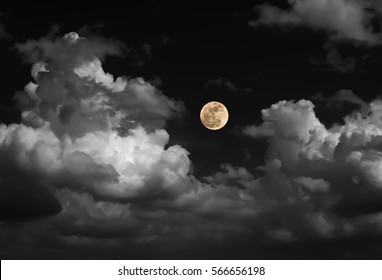 blur moon on black and white sky with cloud