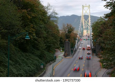 Blur motion of car driving on Lions Gate Bridge at Stanley Park in Vancouver BC Canada