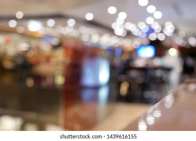 Blur motion of people enjoy meal inside Chinese restaurant with bokeh lighting