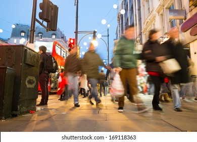 Blur movement of city people worker, shopping on Oxford Street, London, England, UK