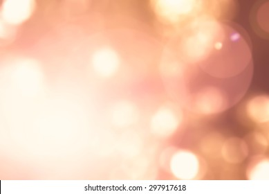 Blur nature background view looking up autumn orange foliage tree leaf against sky facing sun flare bokeh