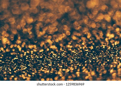 Blur neon gold light circle background. Sparkling firework bokeh dots in retro film filter style. Luxury and classy new year and christmas celebration textured backdrop. Blurry golden dust particles.