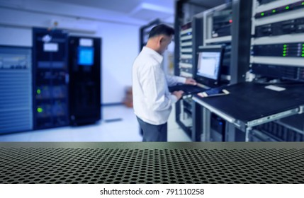blur network administrator in data center room and copy space