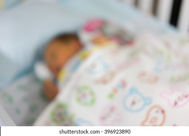 blur newborn baby sleeping in baby bed