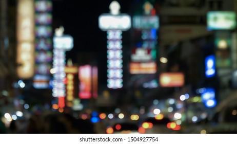 Blur night city background of famous traveller landmark chinatown at Yaowarat , Bangkok , Thailand.