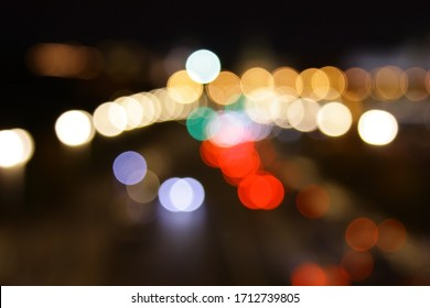 Blur of night route background with side horizontally. The night road with the prospect of leaving blurred side lights on a dark background is horizontal. Copy space