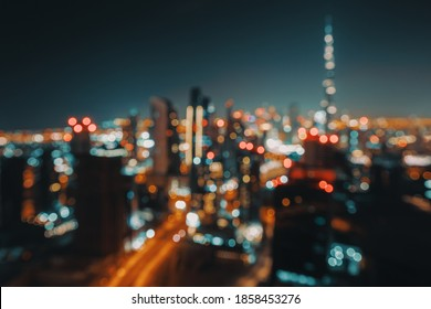 Blur Nighttime Cityscape. Abstract Background of an Urban Night Scene. Bokeh Lights. Modern City of Dubai. United Arab Emirates.